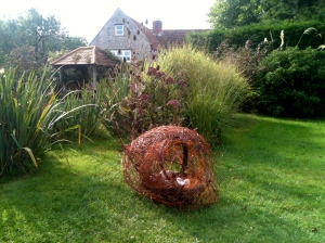 Giant Nest   reclaimed copper wires, twine and old light bulbs